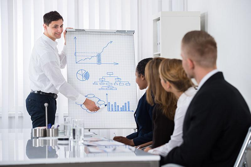 man presenting his sales training techniques to a group