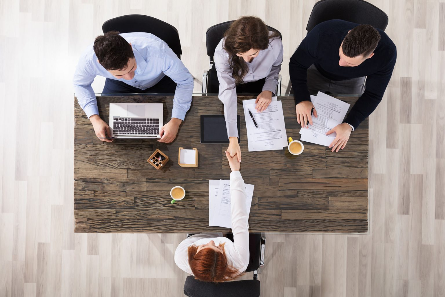 3 interviewers using their interview panel training in a real life interview
